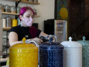 Co-owner Kat Stein fills a kettle at the Dandelion Teahouse & Apothecary soft opening in downtown Vancouver.