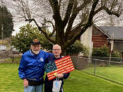 """WASHOUGAL: At left is Bob Rodgers with Robert """"Bob"""" Peake, holding the wooden flag that was presented to Peake on his 90th birthday by the Patriot Guard."""
