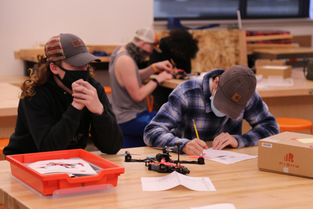 RIDGEFIELD: Tucker Alexander and Caden Anderson worked as a team to build a drone in Steve Rinard's engineering class