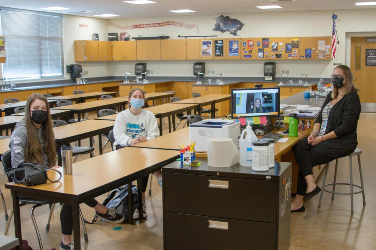 WOODLAND: From left is senior Ruby Heidgerken, junior Bella Mattison, junior Casey Logan via Google Meets, and teacher Elizabeth Talvitie.