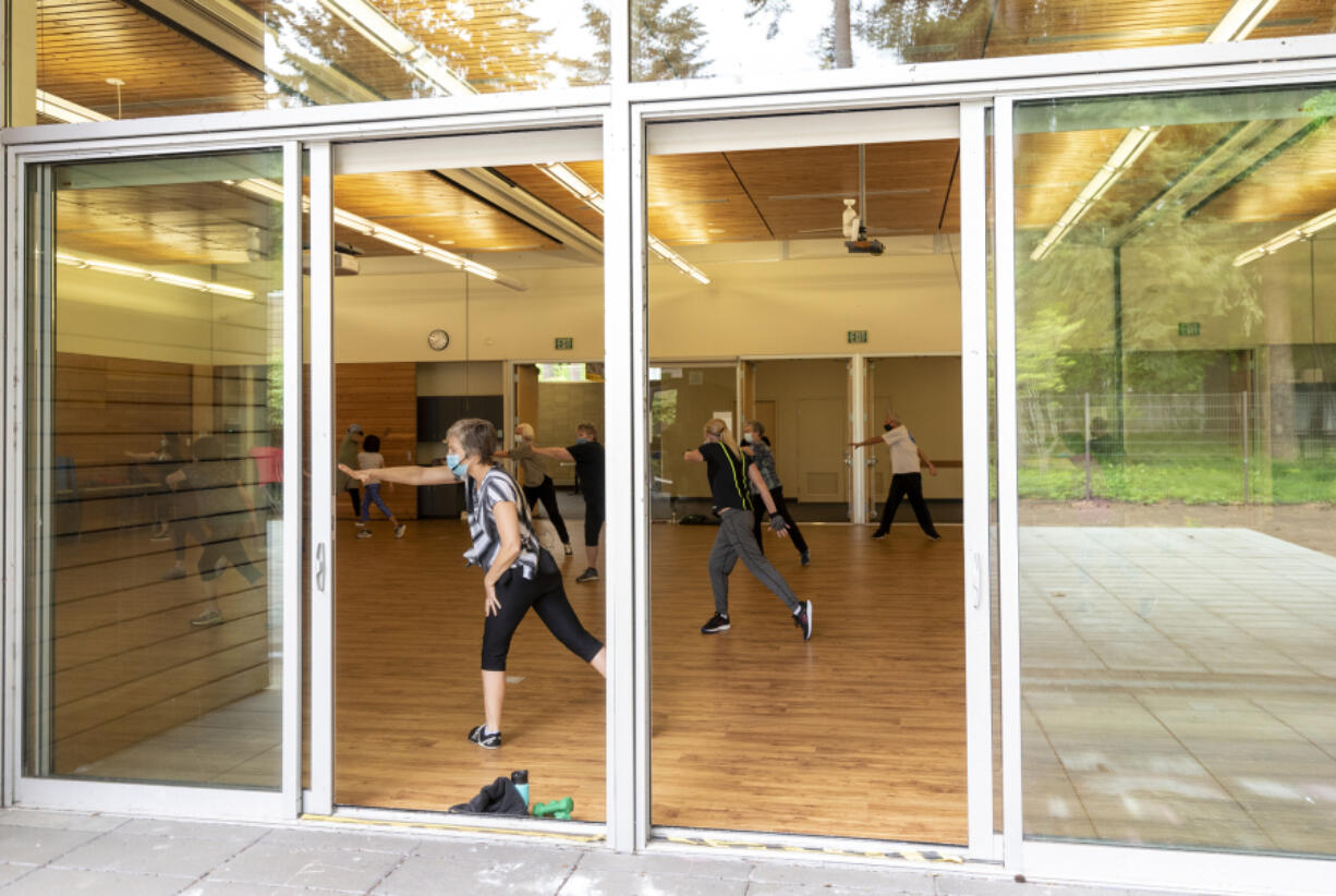 Patrons work out during a cardio and strength class Thursday at the Firstenburg Community Center. The center has recently lessened some of its COVID-19  restrictions and expanded its class offerings.