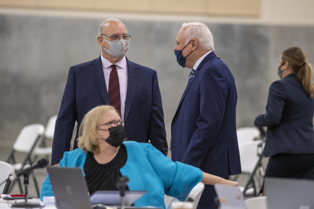 Plaintiffs Chris Clifford, clockwise from left, Don Benton and Susan Rice pause to talk during a break from the lawsuit trial Wednesday at the Clark County Event Center at the Fairgrounds.