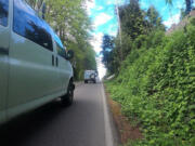 This bike-view photo of a near-miss on Northwest Seward Road shows just how closely some drivers pass beside cyclists in the roadway who have nowhere else to go - no shoulder or bike lane. A 2020 state law requires that drivers give cyclists in the road at least 3 feet of space, if not a whole lane.