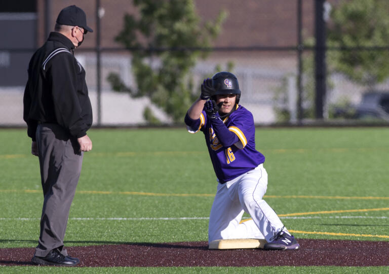 Columbia River's Jordan Wiggins claps toward his team's dugout after a double in a 2A Southwest District Tournament third-place game on Friday, May 7, 2021, at the Ridgefield Outdoor Recreation Complex. Columbia River won 3-2 over Washougal in eight innings.