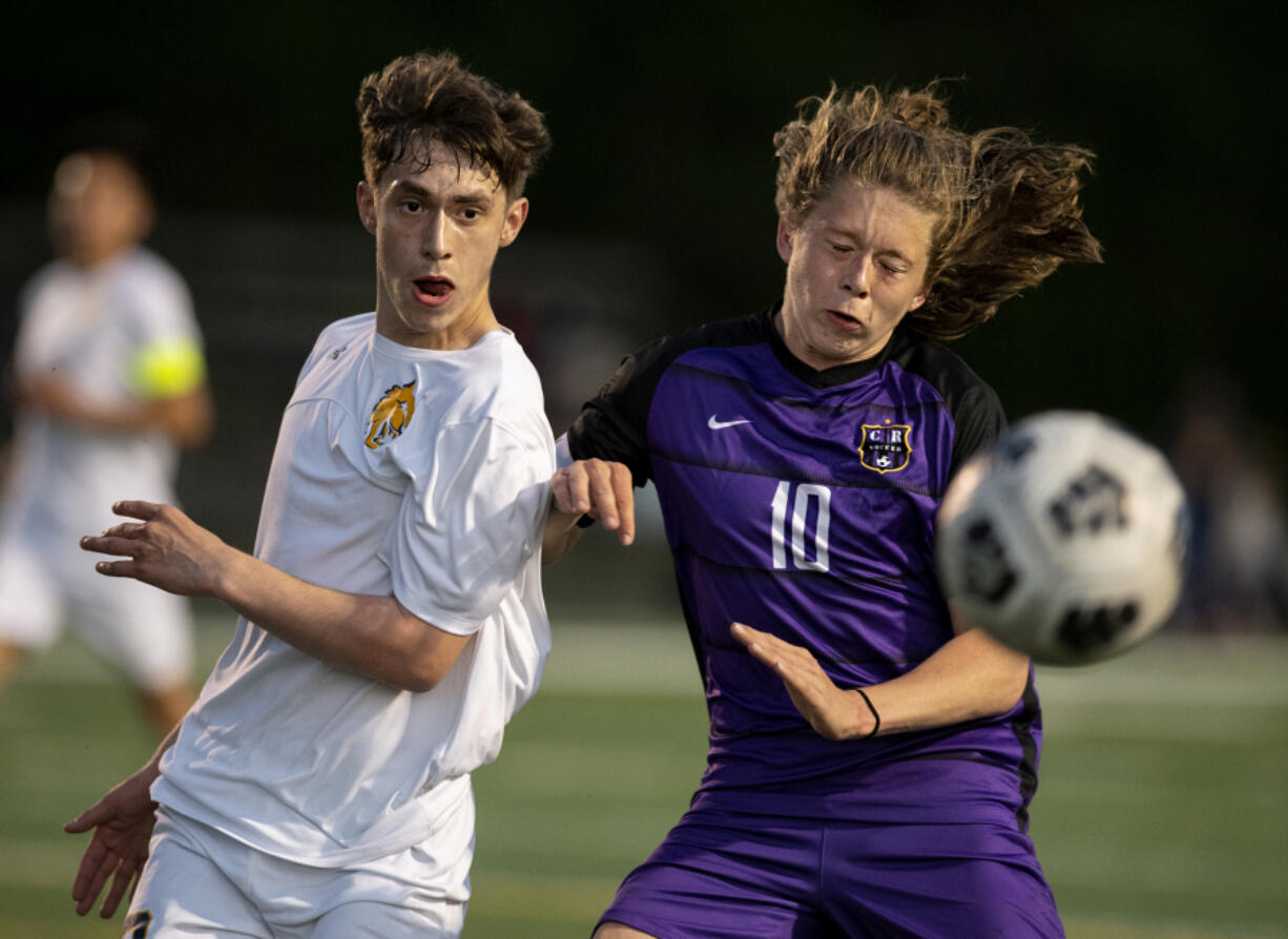 Columbia River'is Greer Snellman battles for a ball with an Aberdeen defender in a 2A Southwest District boys soccer semifinal on Thursday, May 6, 2021, at Columbia River High School. The Rapids topped Aberdeen 2-0 to advance to Saturday'is championship game against Tumwater.
