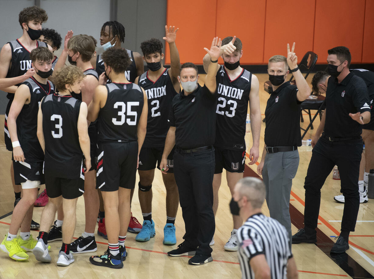 Members of the Union basketball team thank Battle Ground for a good game following their win at Battle Ground High School on Tuesday night, May 11, 2021.