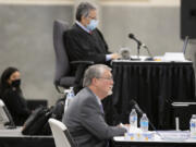 Former Clark County manager Mark McCauley, center, testifies Monday in the trial for a lawsuit brought by Don Benton against the county as Superior Court Judge Gregory Gonzales, top, looks on at the Clark County Event Center at the Fairgrounds.