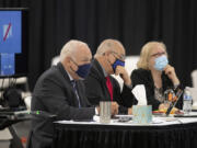 Plaintiffs Don Benton, from left, Christopher Clifford and Susan Rice wait to hear testimony Monday from former Clark County manager Mark McCauley in the trial for a lawsuit brought by them, at the Clark County Event Center at the Fairgrounds.