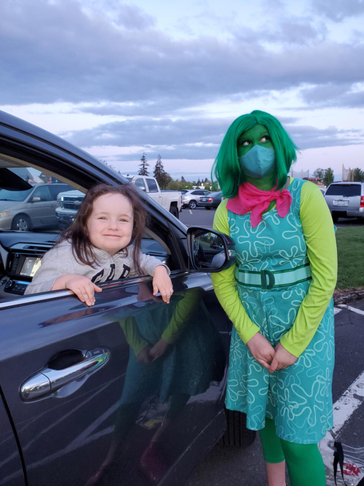 """BATTLE GROUND: The character Disgust from the movie """"Inside Out"""" visited with families at a drive-in movie event on May 7."""