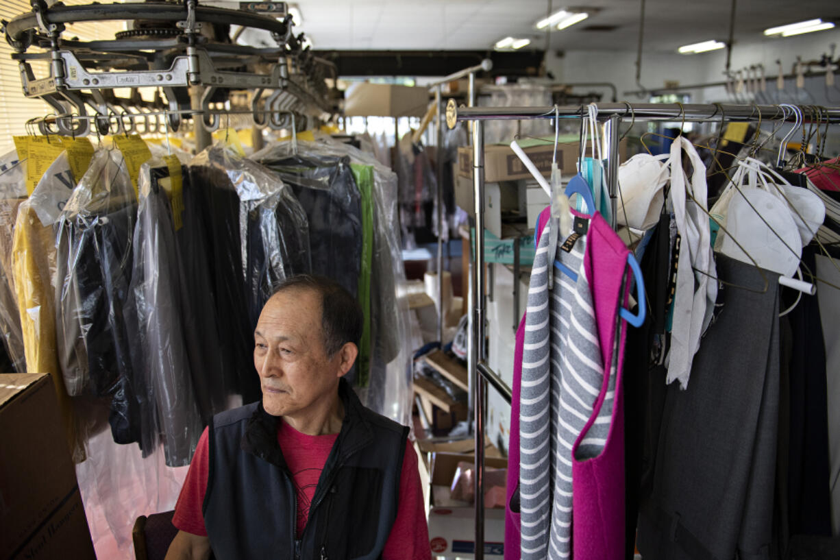 Haeng Chong, who's owned Fourth Plain One Hour Dry Cleaning for 40 years with his wife, pauses for a portrait Wednesday, May 12. Last year, Chong's business received $16,000 through a small business grant program that just reopened for a third time. Applications are due May 19.