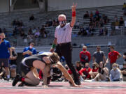 Longtime referee Dick Ford signals two points for a takedown as Camas' Porter Craig wrestles Mountain View's Noah Messman at a 4A/3A Greater St. Helens League meet on Saturday, May 15, 2021, at Doc Harris Stadium in Camas.