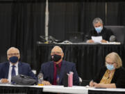 Plaintiffs Don Benton, foreground from left, Christopher Clifford and Susan Rice join Superior Court Judge Gregory Gonzales, background top, as they gather for closing arguments in their lawsuit against the county Monday afternoon at the Clark County Event Center at the Fairgrounds.