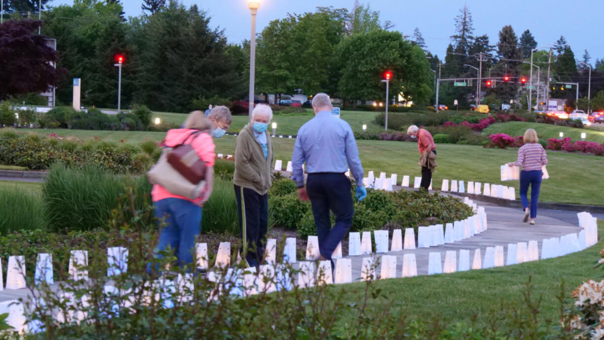 NORTH GARRISON HEIGHTS: PeaceHealth Southwest Medical Center held a luminary display event to honor lives lost from COVID-19, as well as caregivers and hospital workers.