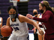 Heritage senior Katie Peneueta weaves toward the basket Thursday, May 20, 2021, during the Timberwolves' 53-42 win against the Falcons at Heritage High School in Vancouver.