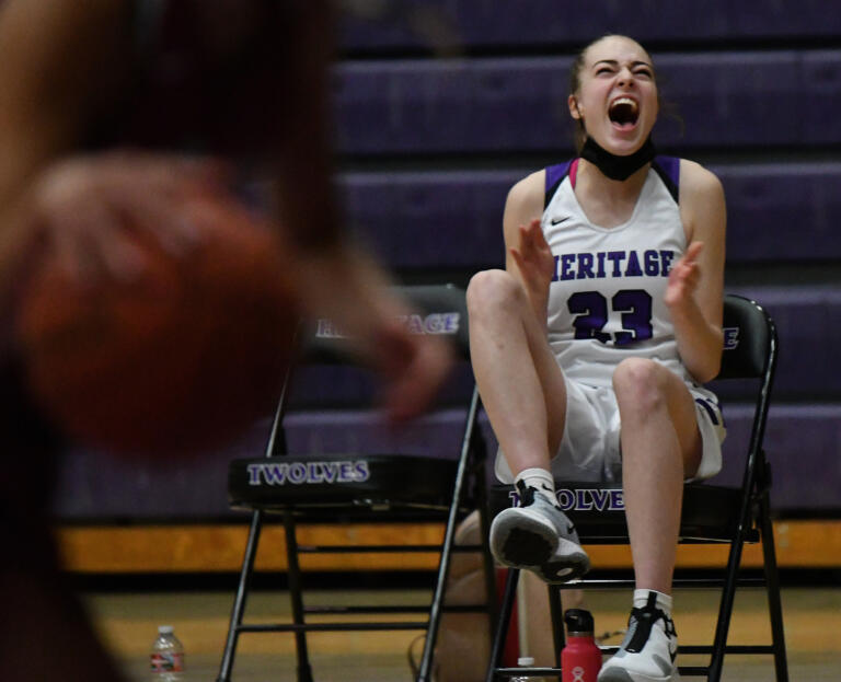 Heritage junior Paige Kirby celebrates after a three-point shot Thursday, May 20, 2021, during the Timberwolves' 53-42 win against the Falcons at Heritage High School in Vancouver.