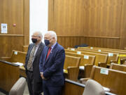 Plaintiffs Christopher Clifford, left, and Don Benton stand after the verdict in their lawsuit trial in a nearly empty courtroom at the Clark County Courthouse on Thursday morning, May 20, 2021.