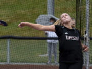 Union junior Ariel Ammentorp throws the discus in a 4A/3A Greater St. Helens League dual on Tuesday, May 25, 2021, at Union High School. Ammentorp, a three-sport athlete, quickly took a liking to the hammer throw last summer and now garners college interest from Arizona, USC and Army.