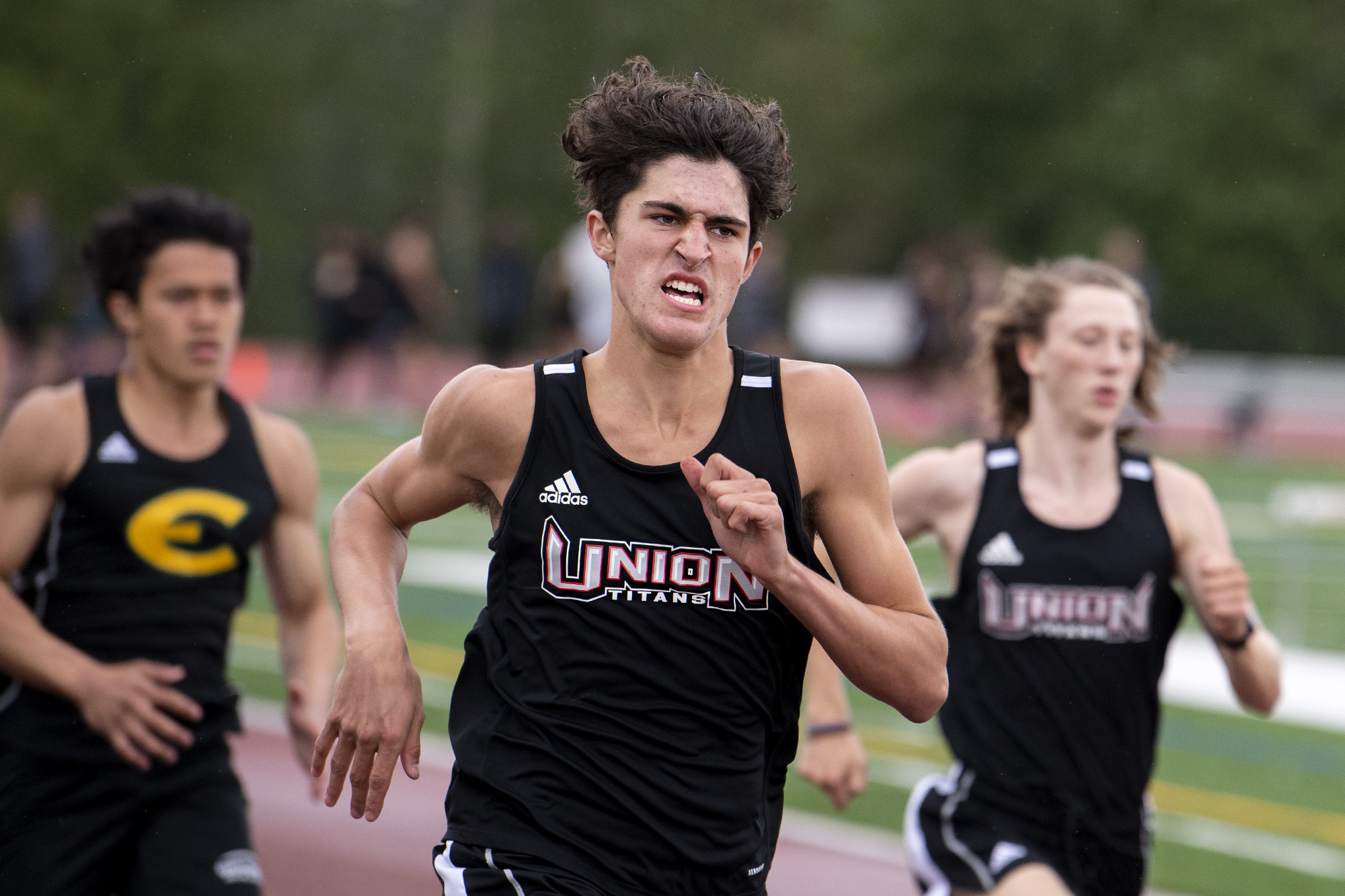 Union freshman Grayson Caldwell hustles his way down the back straight of the 400-meter race in a 4A/3A Greater St. Helens League dual on Tuesday, May 25, 2021, at Union High School. Caldwell finished second with a personal-best 52.82-second mark.