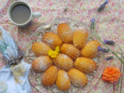 Enjoy a warm, buttery madeleine straight from the oven with a cup of strong French coffee.