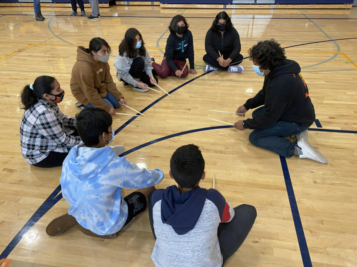 WASHOUGAL: Eddie Esparza, One of a Kind Drum Line, works with La Chispa participants at Jemtegaard Middle School.