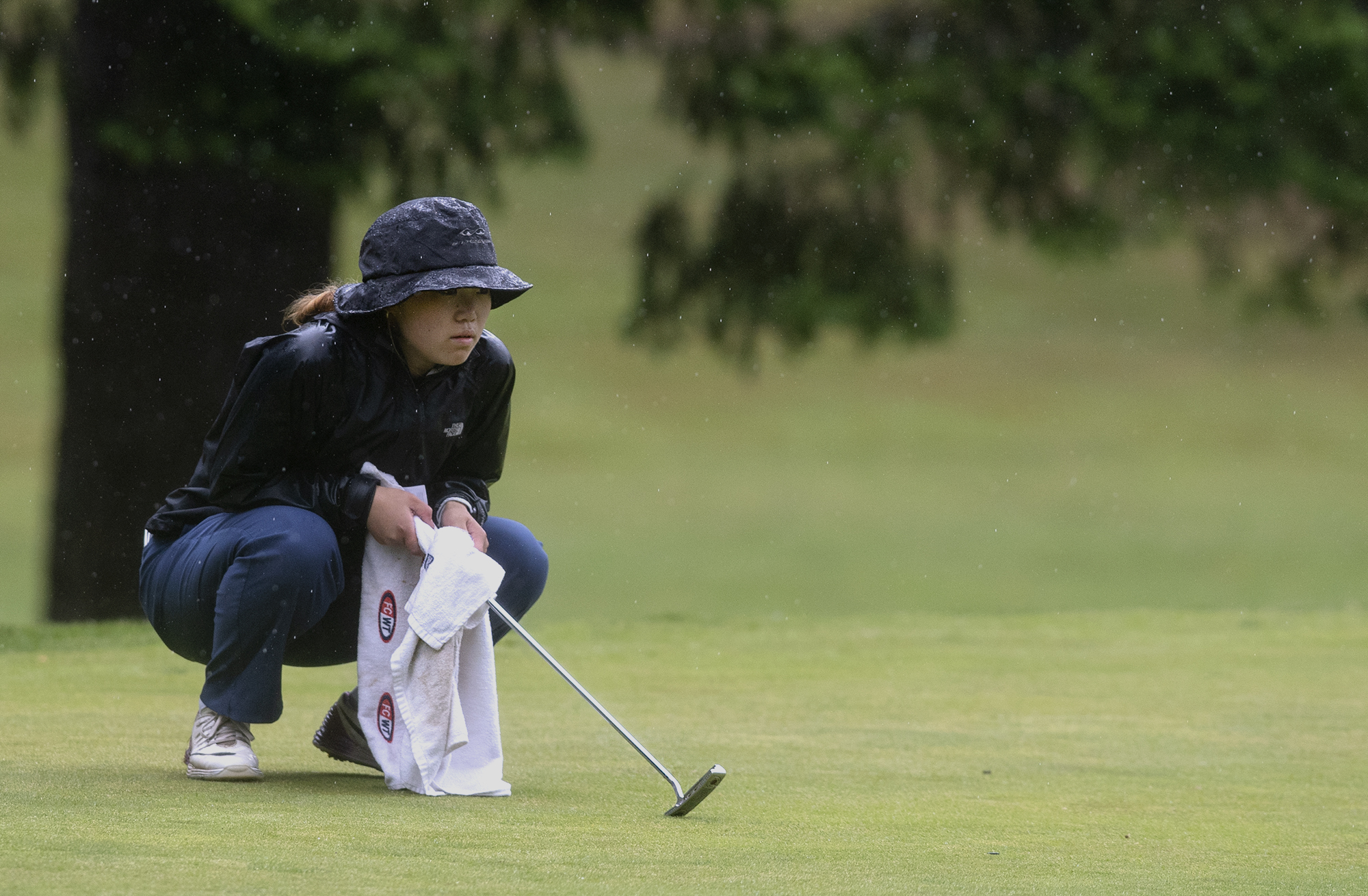 Union's Jade Gruher reads a putt on the 11th hole in the 4A/3A district girls golf championships on Thursday, May 27, 2021, at Lewis River Golf Course in Woodland. Union sophomore Jade Gruher won the 4A title with a 76-77-185 total over two days. Kelso senior Liz Dolan scored a 74-80-186 to win the 3A title.