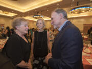 Vancouver resident Jane Jacobsen, from left, congratulates Michele and Greg Goodwin at an event at the Hilton Vancouver Washington in June 2017.