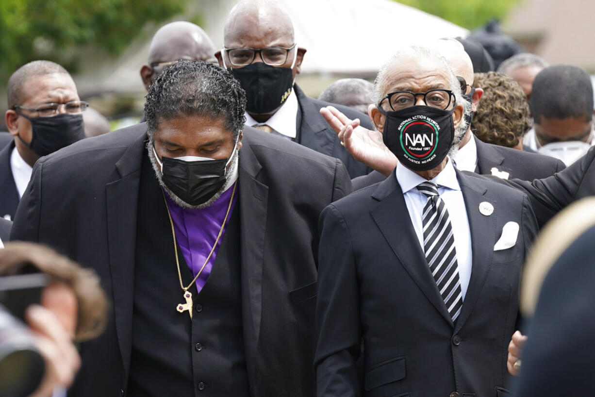 Rev. William Barber II, left and Rev. Al Sharpton arrive for the funeral for Andrew Brown Jr., Monday, May 3, 2021 at Fountain of Life Church in Elizabeth City, N.C. Brown was fatally shot by Pasquotank County Sheriff deputies trying to serve a search warrant.