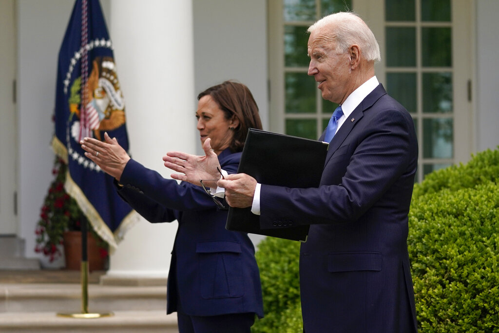 President Joe Biden claps with Vice President Kamala Harris after speaking on updated guidance on face mask mandates and COVID-19 response, in the Rose Garden of the White House, Thursday, May 13, 2021, in Washington.