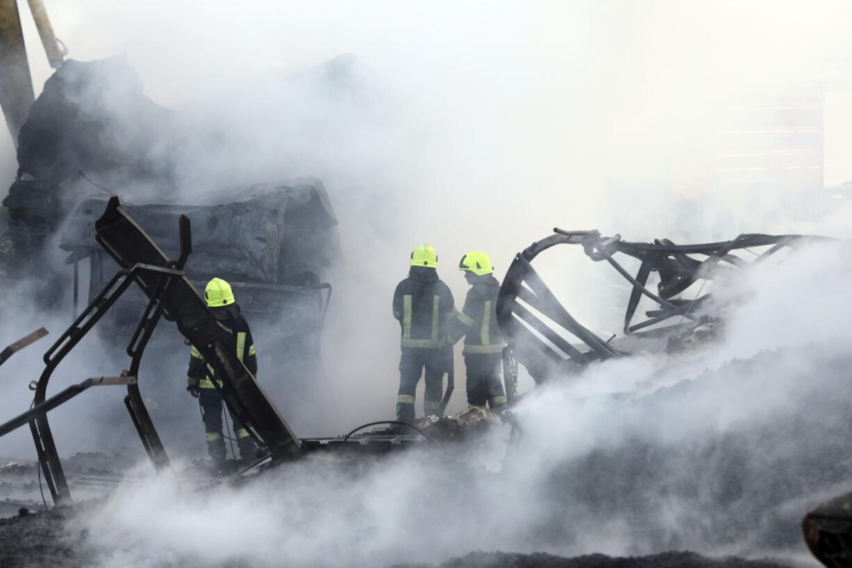 Firefighters work to extinguish burning fuel tankers in Kabul, Afghanistan, Sunday, May 2, 2021. A fire roared through several fuel tankers on the northern edge of the Afghan capital late Saturday, injuring at least 10 people and plunging much of the city into darkness, officials said.
