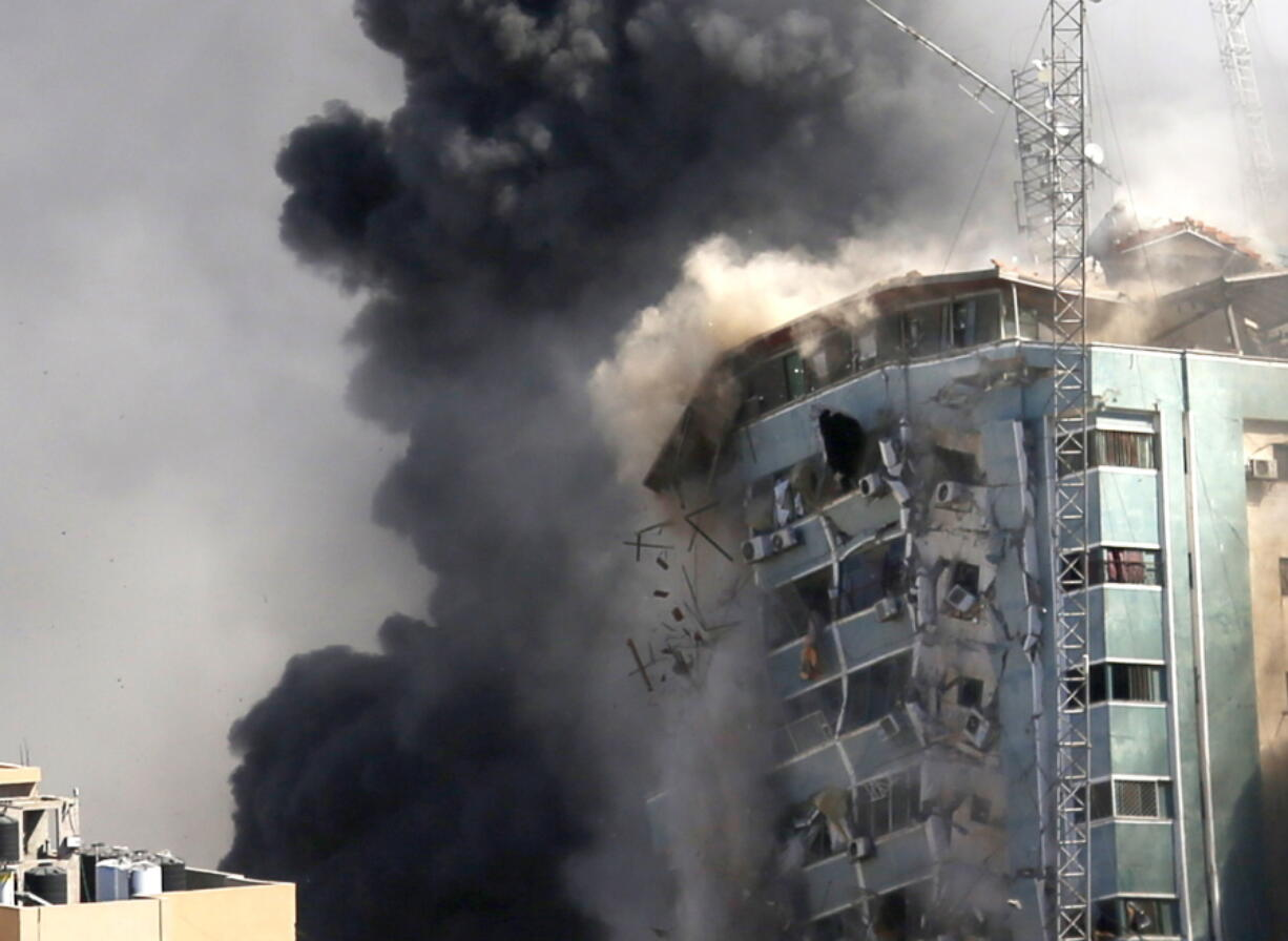 The building housing the offices of The Associated Press and other media in Gaza City collapses after it was hit by an Israeli airstrike Saturday, May 15, 2021. The attack came roughly an hour after the Israeli military warned people to evacuate the building, which also housed Al-Jazeera and a number of offices and apartments. There was no immediate explanation for why the building was targeted.