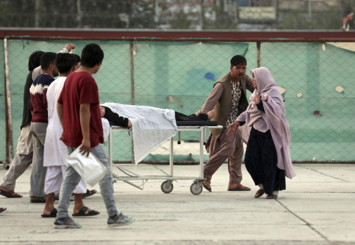 An injured school student is transported to a hospital after a bomb explosion near a school west of Kabul, Afghanistan, Saturday, May 8, 2021. A bomb exploded near a school in west Kabul on Saturday, killing several, many them young students, Afghan government spokesmen said.
