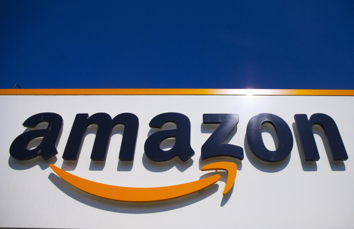FILE - In this April 16, 2020, file photo, the Amazon logo is displayed in Douai, northern France.  Amazon said Tuesday, May 18, 2021,  that it will continue to ban police use of its face-recognition technology beyond the one-year ban it announced last year.