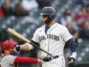 Seattle Mariners' Ty France walks away from the plate after striking out against the Los Angeles Angels during the third inning of a baseball game Saturday, May 1, 2021, in Seattle.