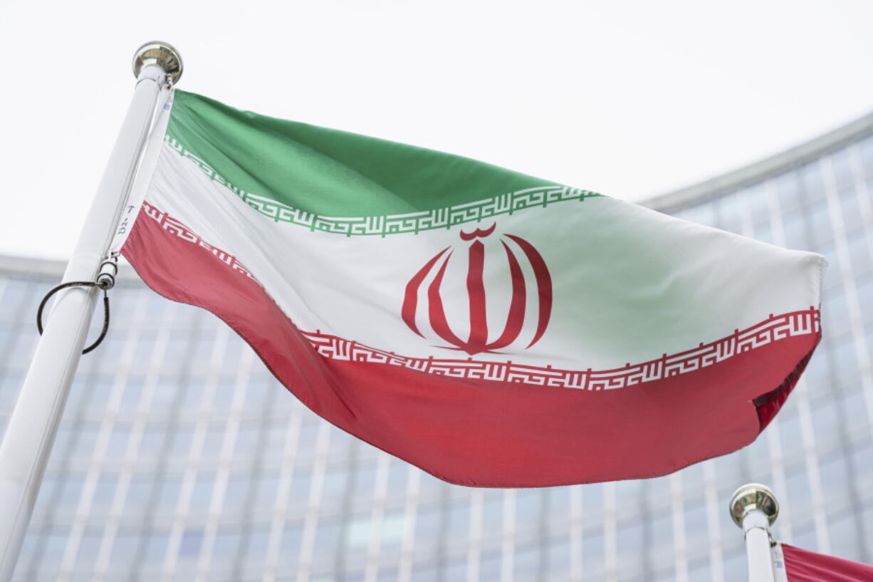 FILE - In this Monday, May 24, 2021 file photo, the flag of Iran waves in front of the the International Center building with the headquarters of the International Atomic Energy Agency, IAEA, in Vienna, Austria, Monday, May 24, 2021.  The United Nations' International Atomic Energy Agency watchdog reported Monday May 31, 2021, it hasn't been able to access data important to monitoring Iran's nuclear program since late February when the Islamic Republic started restricting international inspections of its facilities.