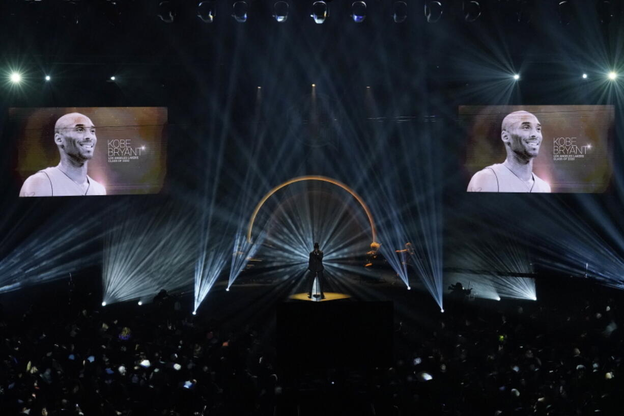 """The late Kobe Bryant is honored, as are others who have died, as Ne-Yo sings """"Incredible"""" during the 2020 Basketball Hall of Fame enshrinement ceremony Saturday, May 15, 2021, in Uncasville, Conn."""