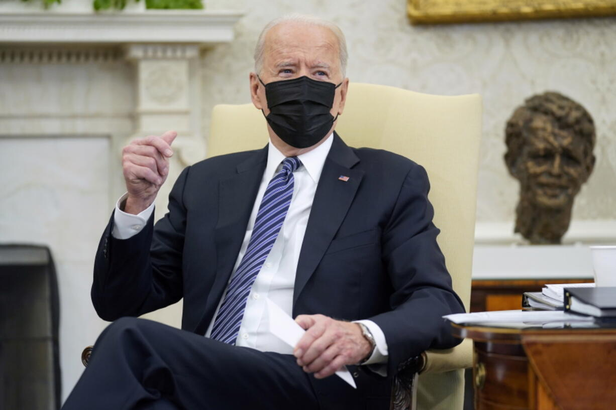 President Joe Biden snaps his fingers as he responds to a reporters question during a meeting with congressional leaders in the Oval Office of the White House, Wednesday, May 12, 2021, in Washington.