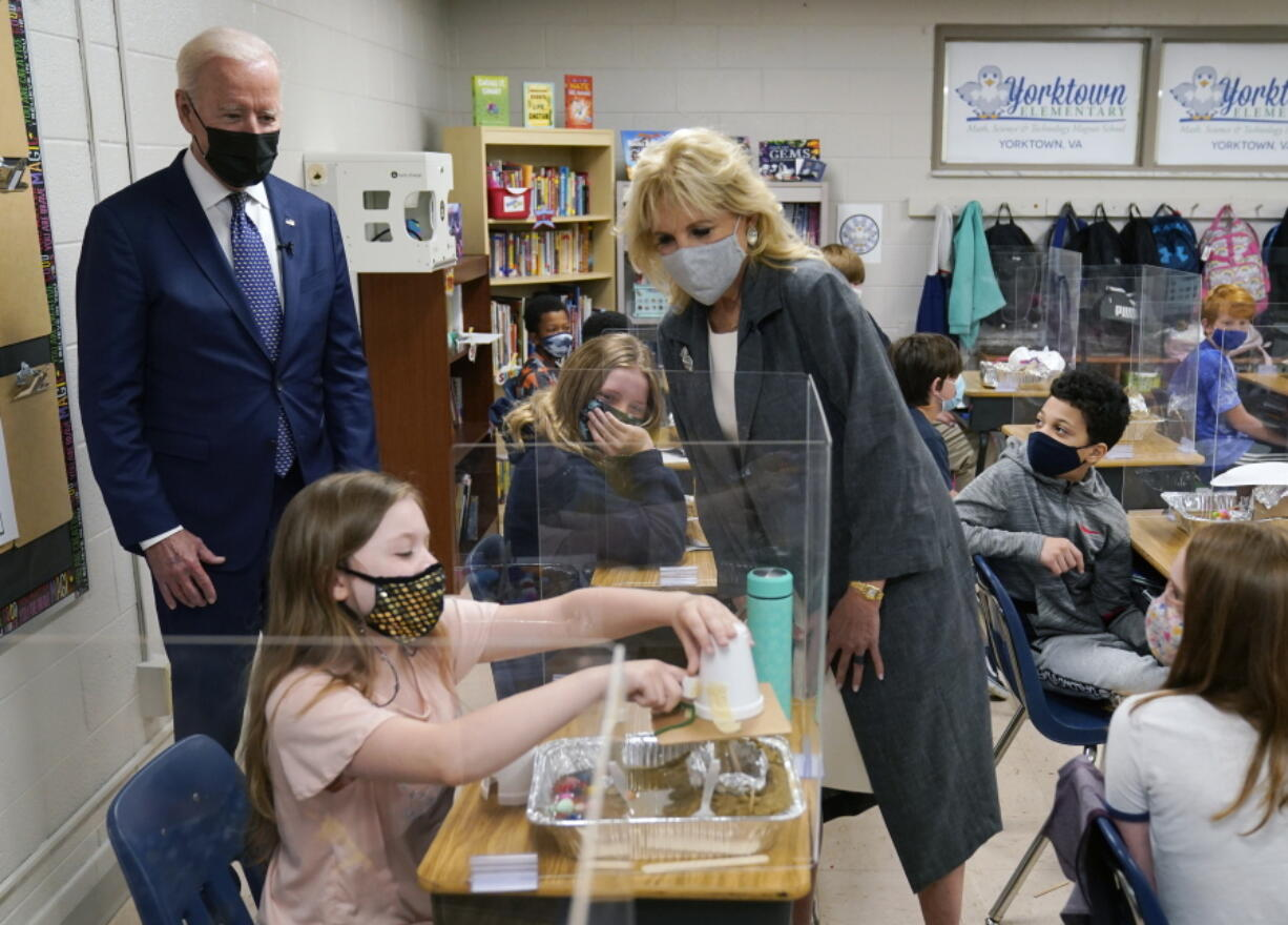 President Joe Biden and first lady Jill Biden, watch a student demonstrate her project, during a visit to Yorktown Elementary School, Monday, May 3, 2021, in Yorktown, Va.