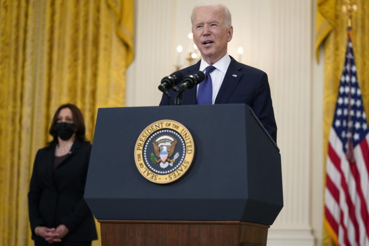 Vice President Kamala Harris, left, listens as President Joe Biden speaks about the economy, in the East Room of the White House, Monday, May 10, 2021, in Washington.