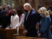 FILE - In this Wednesday, Jan. 20, 2021 file photo, President-elect Joe Biden and his wife, Jill Biden, attend Mass at the Cathedral of St. Matthew the Apostle during Inauguration Day ceremonies in Washington. When U.S. Catholic bishops hold their next national meeting in June 2021, they'll be deciding whether to send a tougher-than-ever message to President Joe Biden and other Catholic politicians: Don't partake of Communion if you persist in public advocacy of abortion rights.