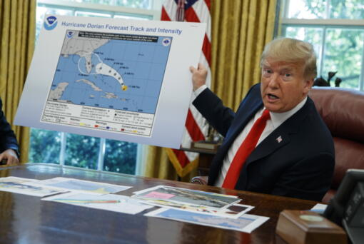FILE - In this Wednesday, Sept. 4, 2019, file photo, President Donald Trump talks with reporters after receiving a briefing on Hurricane Dorian in the Oval Office of the White House, in Washington. A new 46-person federal scientific integrity task force with members from dozens of government agencies will meet for the first time Friday, May 14, 2021. During Sharpiegate, NOAA reprimanded some meteorologists for tweeting that Alabama was not threatened by the hurricane, contradicting the president, who said Alabama was in danger.