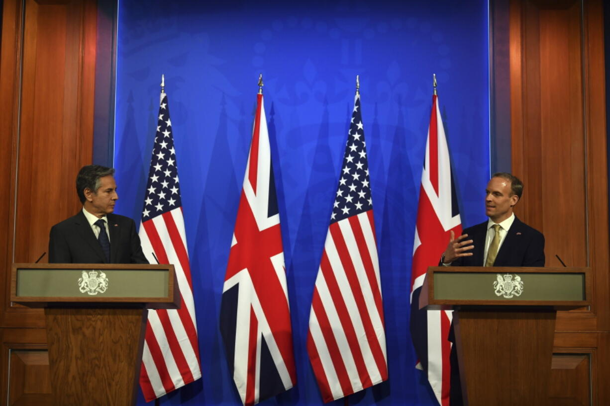 Britain's Foreign Secretary Dominic Raab, right, and US Secretary of State Antony Blinken attend a joint press conference at Downing Street in London, Monday, May 3, 2021, during the G7 foreign ministers meeting.