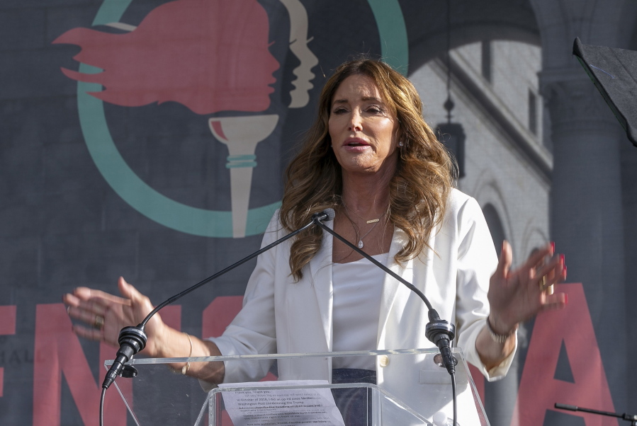 FILE - In this Jan. 18, 2020, file photo, Caitlyn Jenner speaks at the fourth Women's March in Los Angeles. Jenner, and John Cox, two Republicans running to oust California Gov. Gavin Newsom, sought to make a fresh impression with voters Tuesday, May 4, 2021, with the release of new campaign ads, marking a new phase in the pending recall.