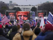 FILE - In this Jan. 6, 2021 file photo, Trump supporters participate in a rally in Washington. Many of those who stormed the Capitol on Jan. 6 cited falsehoods about the election, and now some of them are hoping their gullibility helps them in court. Attorneys for several defendants facing charges connected to the deadly insurrection say they will raise their client's belief in conspiracy theories and misinformation, either as an explanation for why they did what they did, or as an attempt to create a little sympathy.