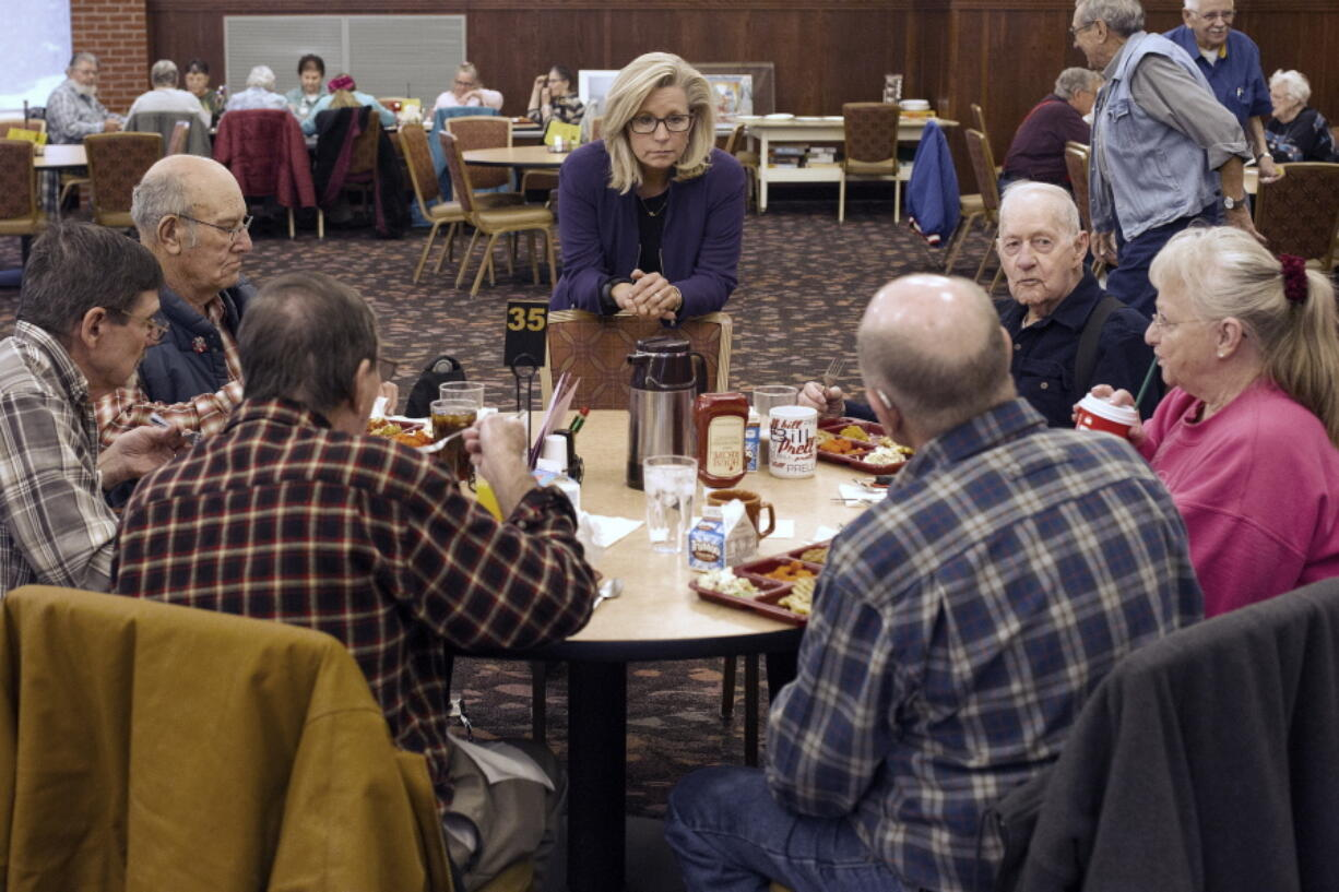 FILE - In this Feb. 1, 2016, file photo, Liz Cheney, center, talks to people at the Senior Citizens Center in Gillette, Wyo., after earlier in the day announcing she would run fro Congress. Removing congresswoman Liz Cheney from House GOP leadership was a relatively easy task for pro-Trump Republicans compared to their growing effort to boot her from office.