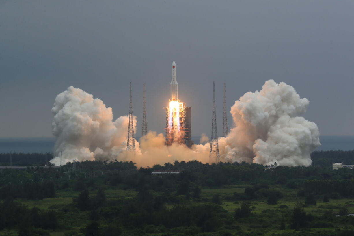 FILE - In this April 29, 2021, file photo released by China's Xinhua News Agency, a Long March 5B rocket carrying a module for a Chinese space station lifts off from the Wenchang Spacecraft Launch Site in Wenchang in southern China's Hainan Province. The central rocket segment that launched the 22.5-ton core of China's newest space station into orbit is due to plunge back to Earth as early as Saturday in an unknown location.