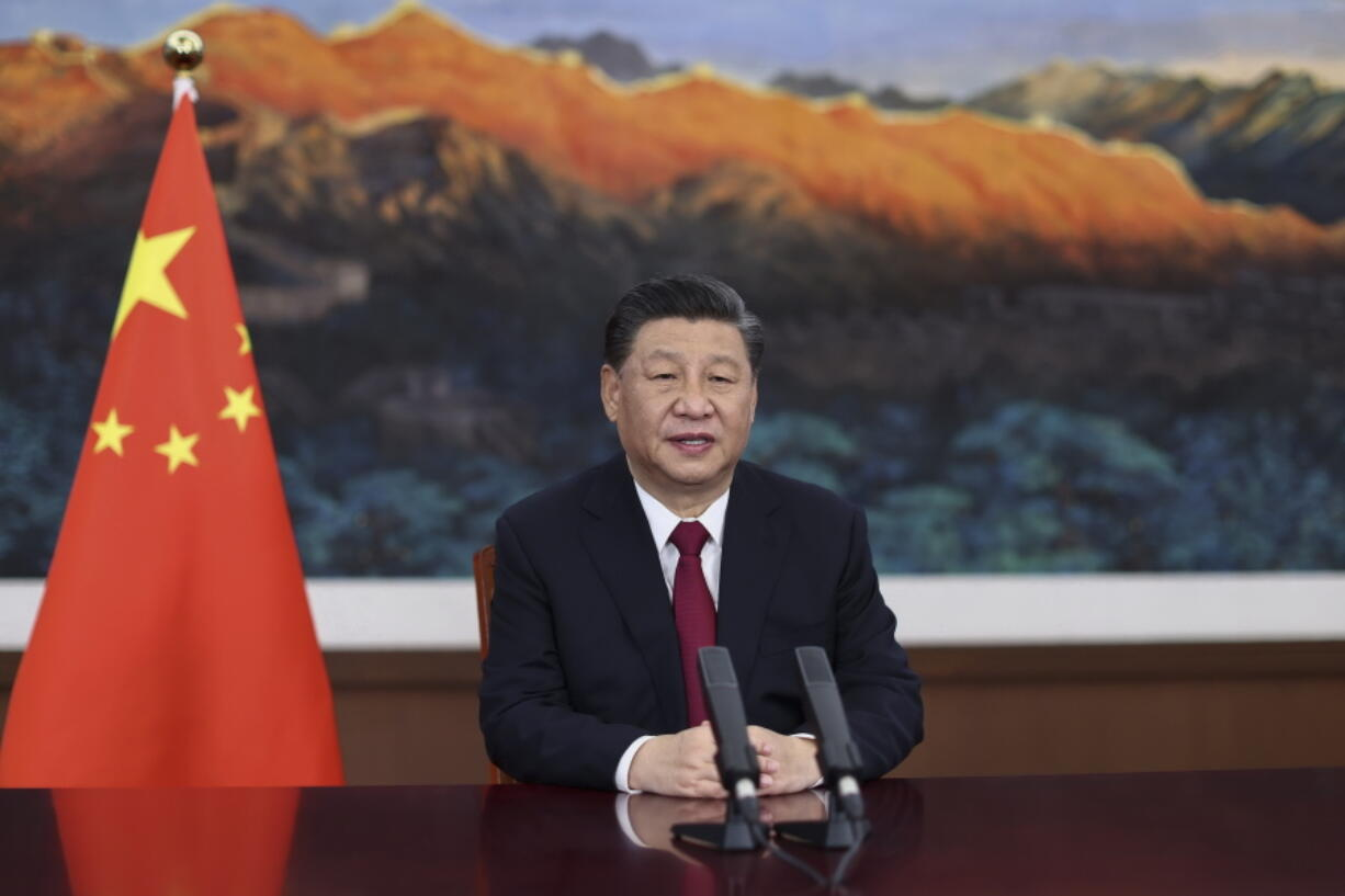 """FILE - In this April 20, 2021 file photo released by Xinhua News Agency, Chinese President Xi Jinping delivers a keynote speech via video for the opening ceremony of the Boao Forum for Asia (BFA) Annual Conference, in Beijing.  A seven-month investigation by the Associated Press and the Oxford Internet Institute, a department at Oxford University, found that the rise of Chinese diplomats on Twitter has been powered by an army of apparently fake accounts that have retweeted their posts tens of thousands of times. The move onto Western social media comes as China wages a war for influence - both at home and abroad -- on the internet, which President Xi Jinping has called """"the main battlefield"""" for public opinion."""