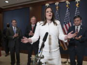Rep. Elise Stefanik, R-N.Y., speaks to reporters at the Capitol in Washington, Friday, May 14, 2021, just after she was elected chair of the House Republican Conference, replacing Rep. Liz Cheney, R-Wyo., who was ousted from the GOP leadership for criticizing former President Donald Trump. She is joined by, from left, Rep. Gary Palmer, R-Ala., House Minority Leader Kevin McCarthy, R-Calif., and Rep. Mike Johnson, R-La. (AP Photo/J.