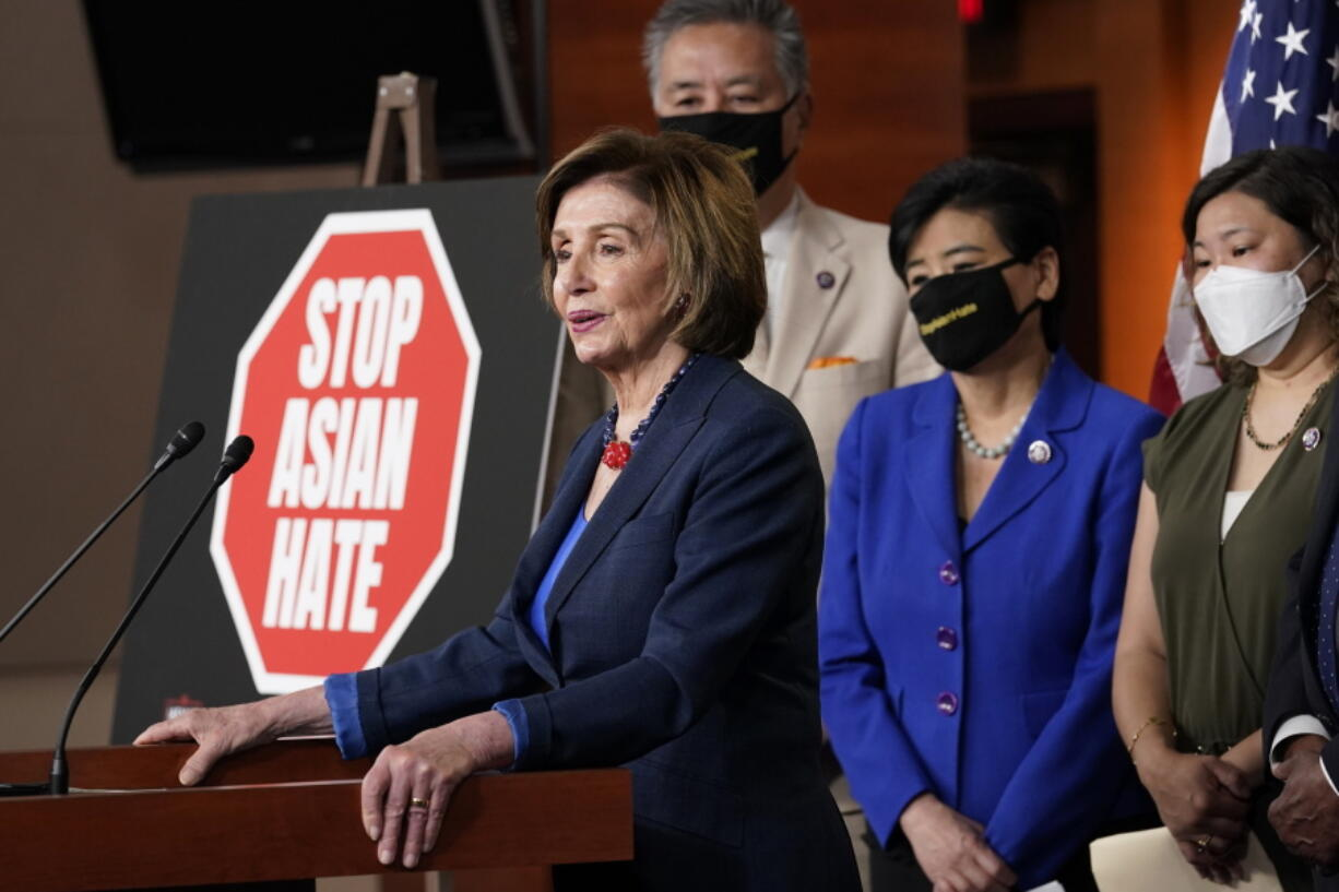 House Speaker Nancy Pelosi of Calif., left, speaks during a news conference on Capitol Hill in Washington, Tuesday, May 18, 2021, on the COVID-19 Hate Crimes Act. Pelosi is joined by Rep. Mark Takano, D-Calif., second from left, Rep. Judy Chu, D-Calif., second from right and Rep. Grace Meng, D-N.Y.