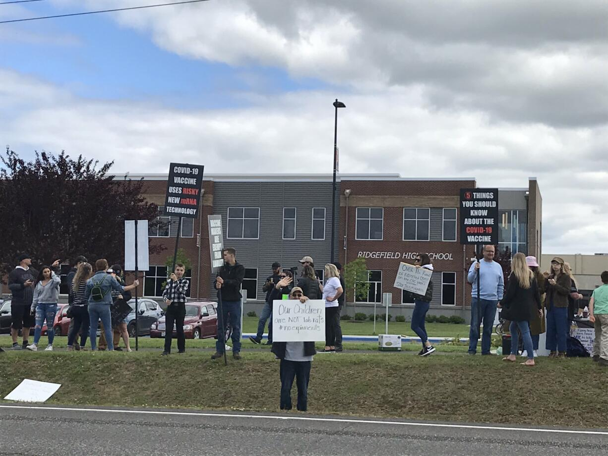Anti-vaccination protesters gather outside Ridgefield High School, which is hosting a COVID-19 vaccination clinic organized by students today.