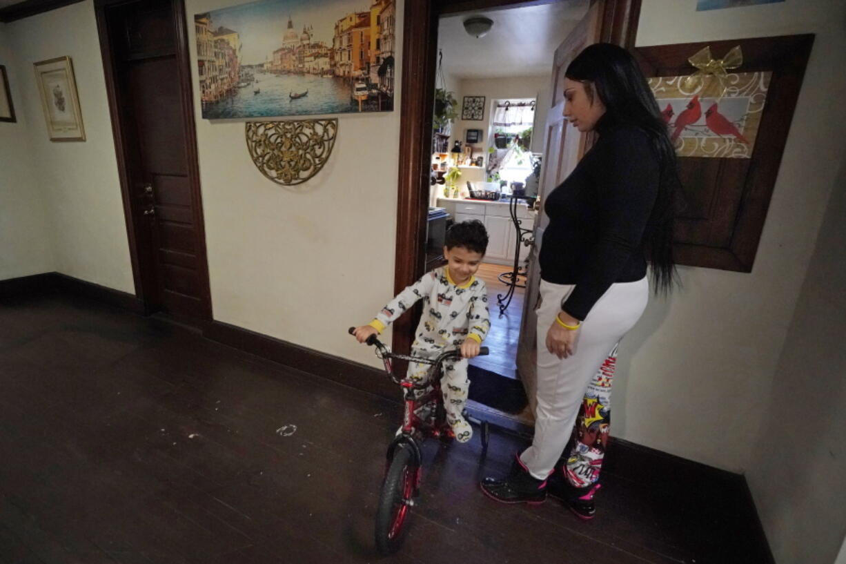 FILE - In this March 10, 2021, file photo, Isabel Miranda's 4-year-old son, Julian, rides his bike into the hallway of their rental apartment in Haverhill, Mass. A federal judge has ruled, Wednesday, May 5, 2021, that the Centers for Disease Control exceeded its authority when it imposed a federal eviction moratorium to provide protection for renters out of concern that having families lose their homes and move into shelters or share crowded conditions with relatives or friends during the pandemic would further spread the highly contagious virus. Miranda and her family would no longer have this eviction protection if this ruling stands.
